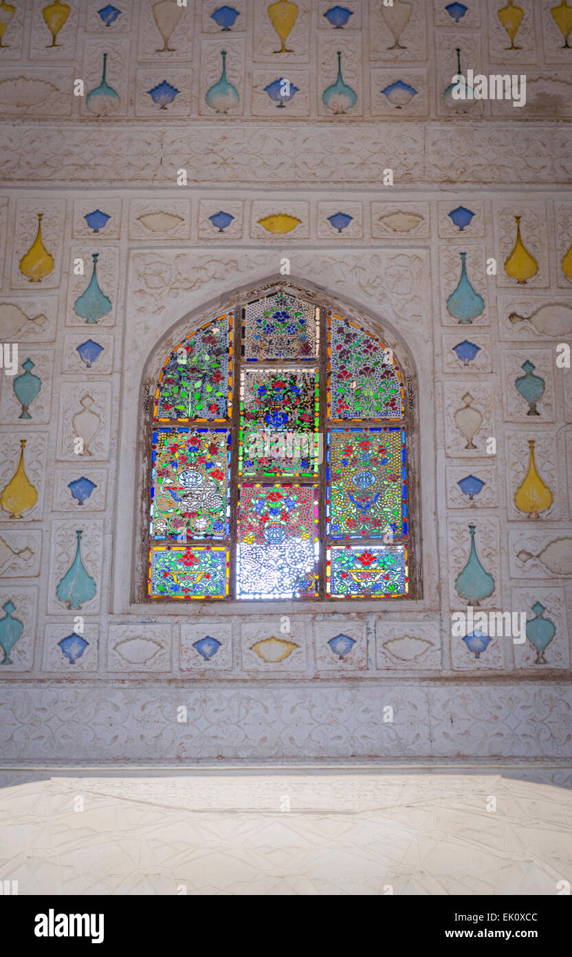 Coloured glass panels at Amber Fort Palace near Jaipur, Rajasthan, India - Stock Image