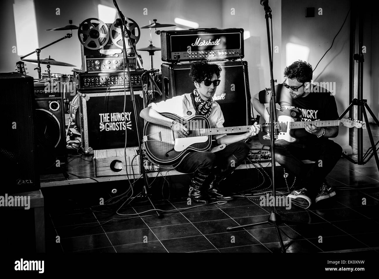The Hungry Ghosts a Redditch U.K band tune up before playing a set at Death or Glory Records in Redditch Worcestershire - Stock Image