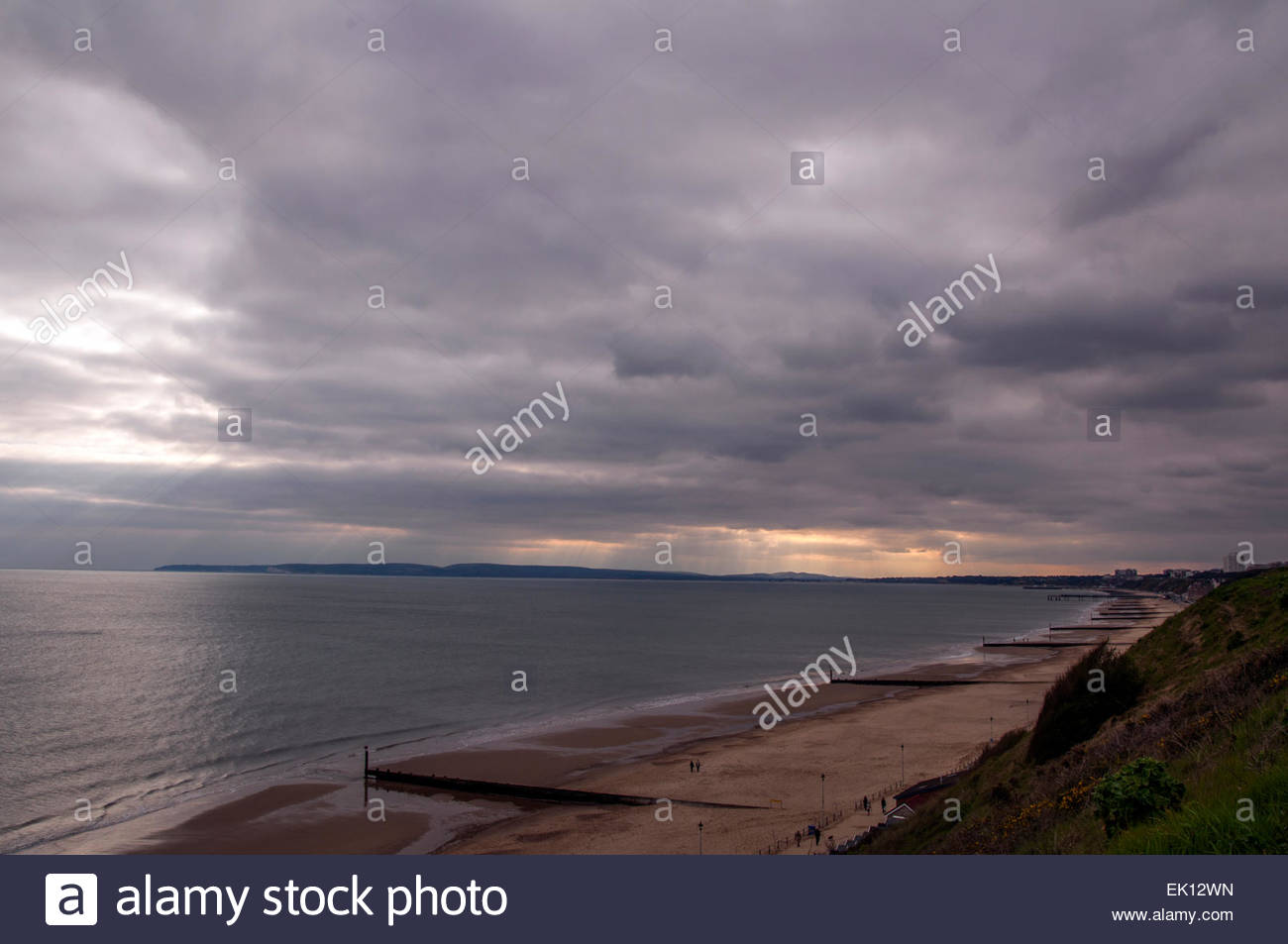 Bournemouth, Dorset, England. 4th April 2015. UK weather. Rays of sunshine break through the thick clouds over the - Stock Image