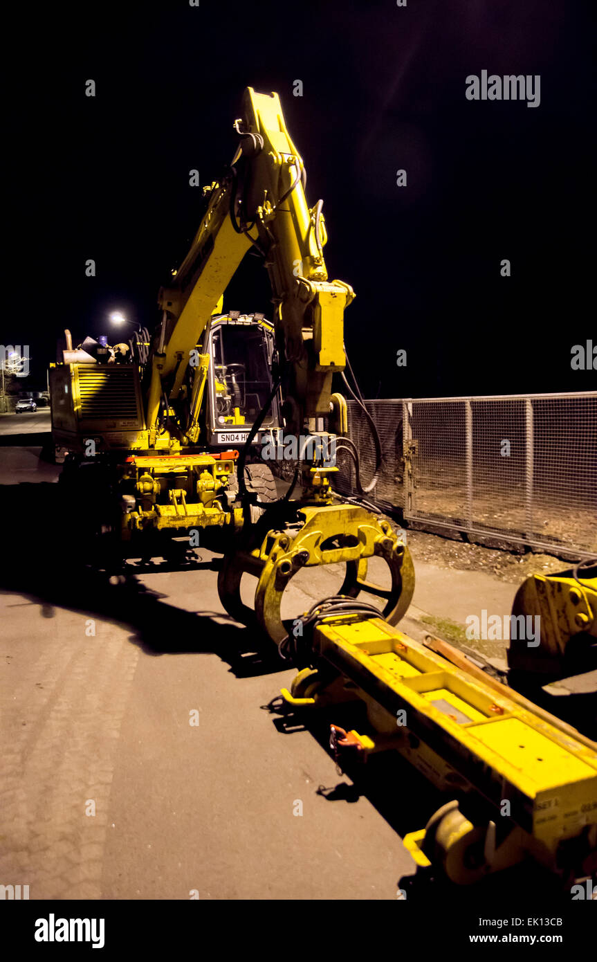 Large building equipment, the yellow meachanical vehicle has a claw which can be used to pick up heavy objects on - Stock Image