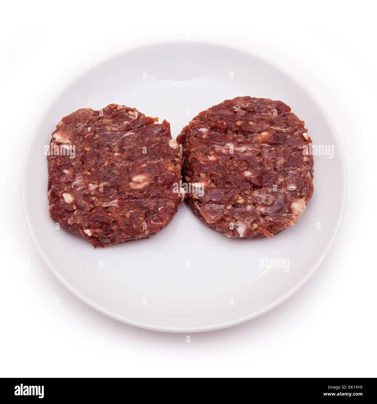 Kangaroo meat burgers uncooked isolated on a white studio background. Stock Photo