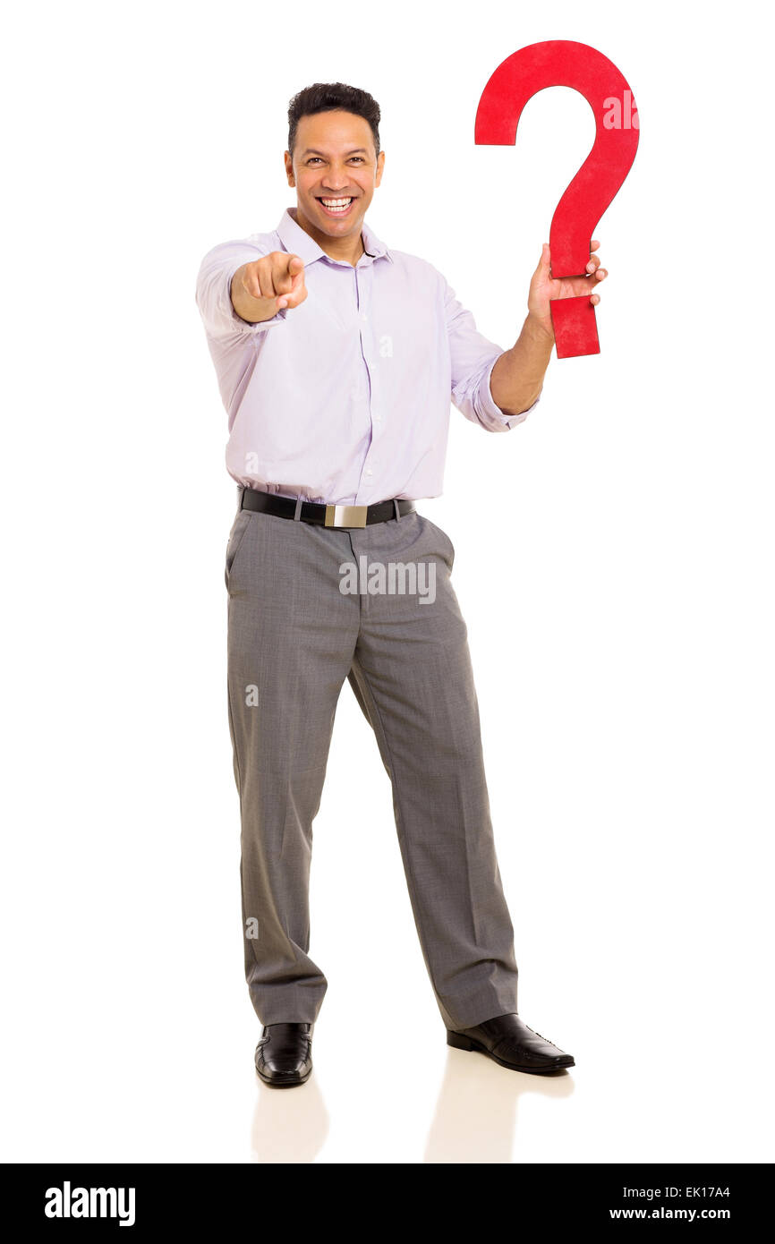 happy man holding question mark and pointing at the camera - Stock Image