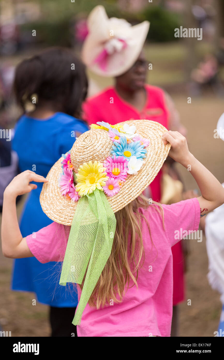 Charleston, South Carolina, USA. 04th Apr, 2015. A young girl holds on to her hat during the annual Hat Ladies Easter - Stock Image