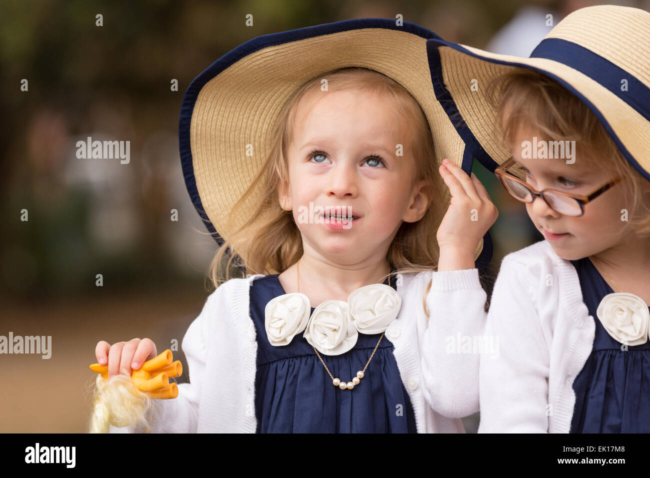 Charleston, South Carolina, USA. 04th Apr, 2015. A group of young triplets in their Easter finery during the annual - Stock Image