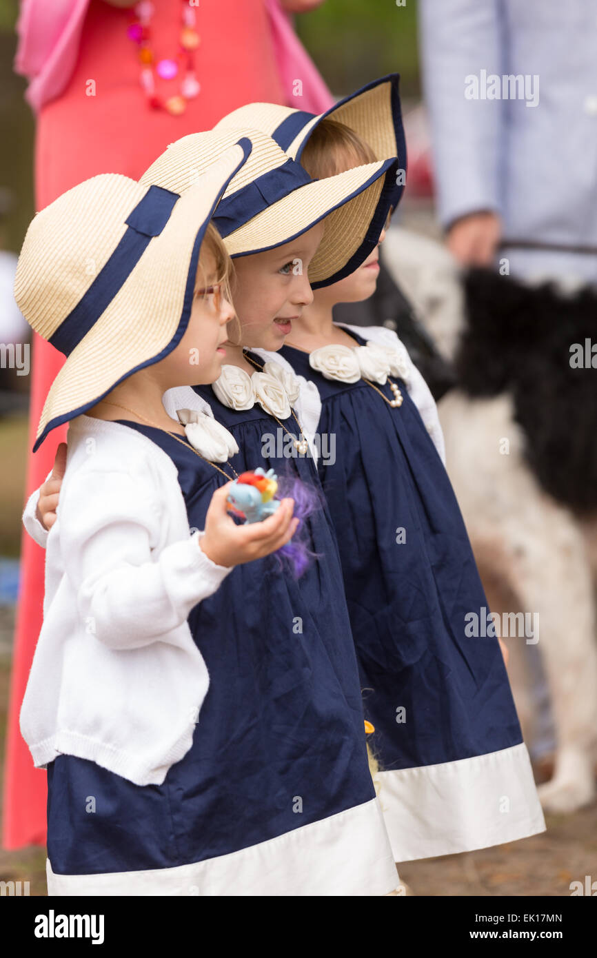 A group of young triplets in their Easter finery during the annual Hat Ladies Easter Promenade in Marion Square - Stock Image