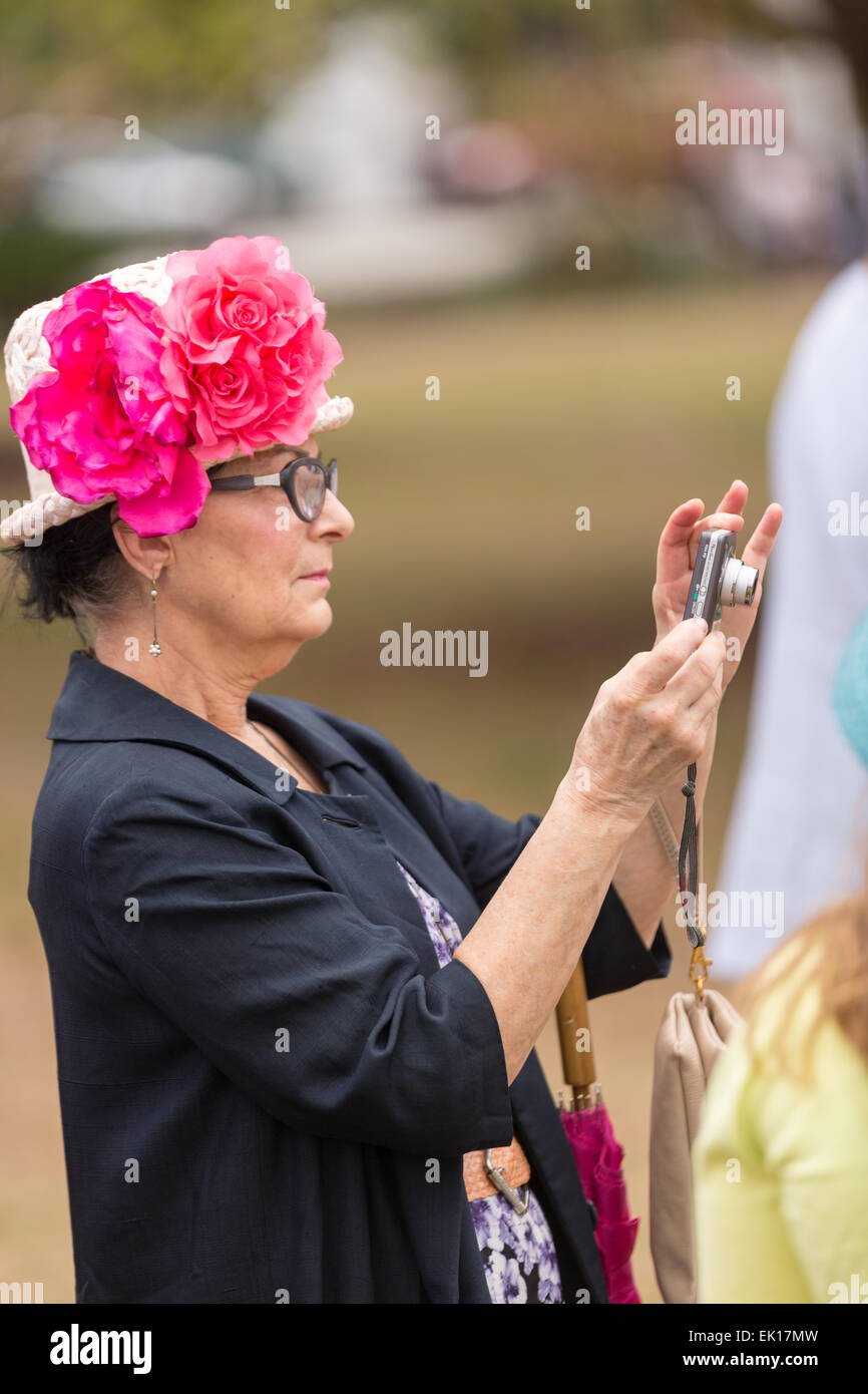 A woman takes a photo of her friends during the annual Hat Ladies Easter Promenade in Marion Square April 4, 2015 - Stock Image
