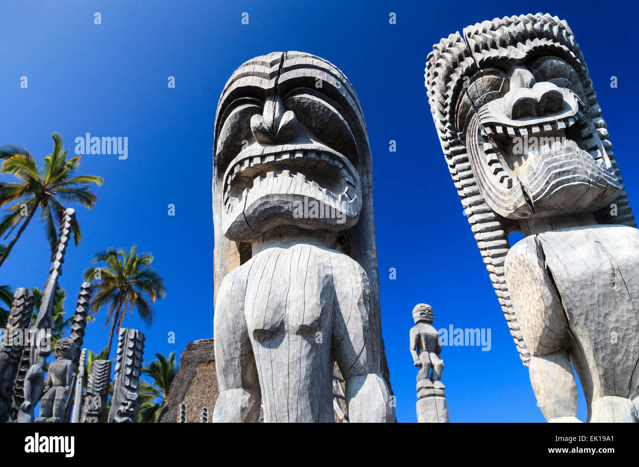Carved figures at Puuhonua O Honaunau National Historical Park on the Big Island - Stock Image