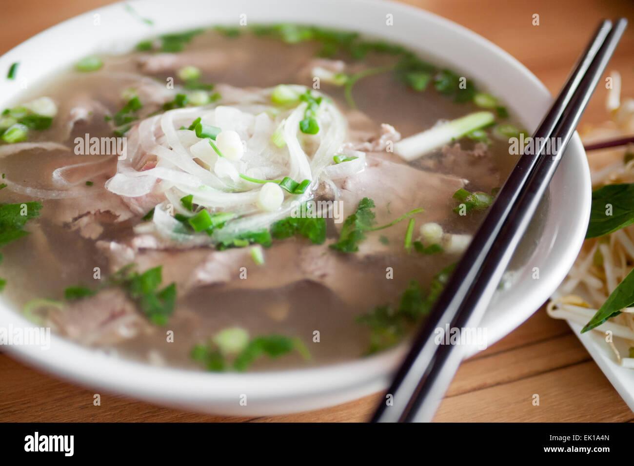 A bowl of beef brisket pho, a popular Vietnamese noodle soup. Stock Photo