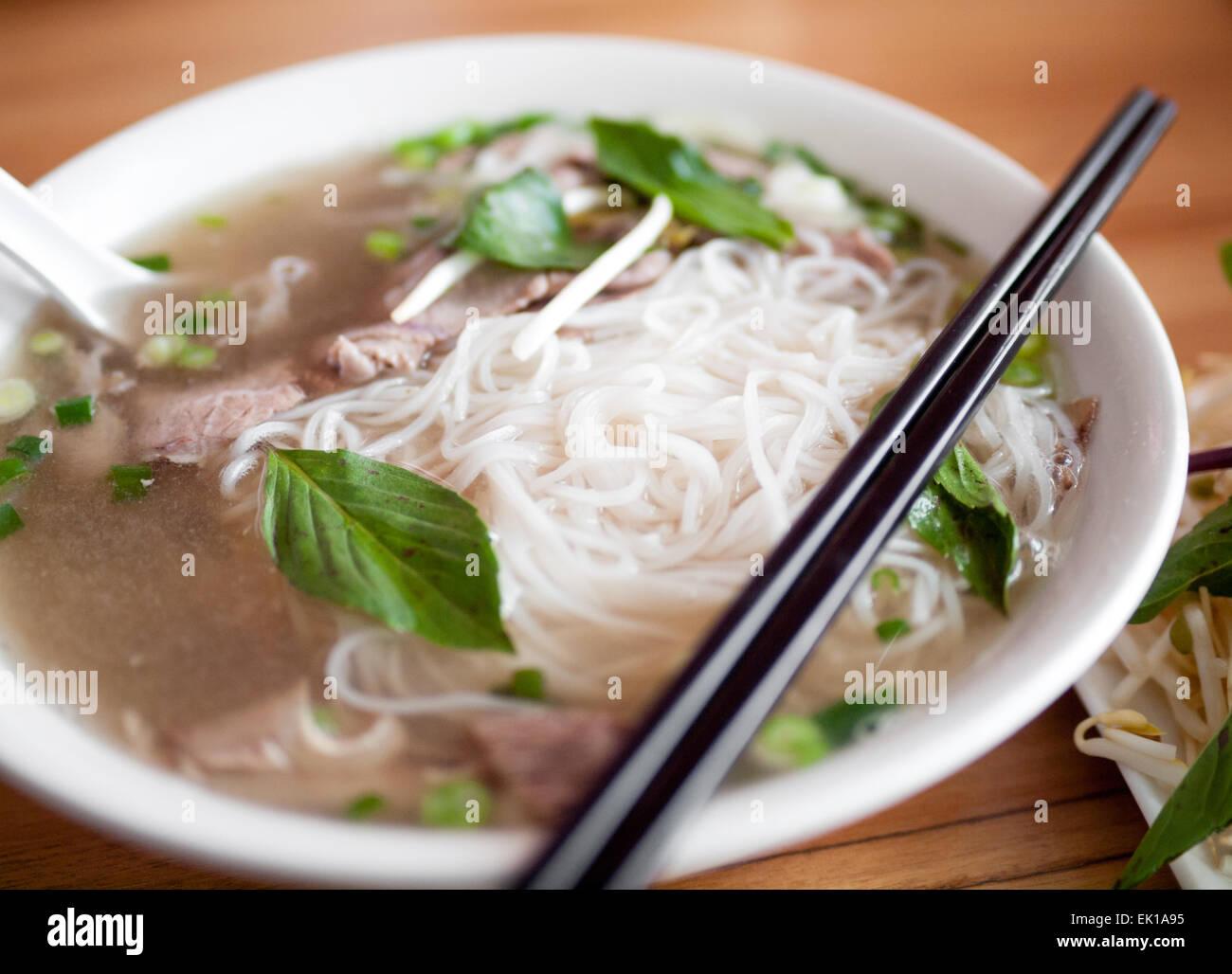 A bowl of beef brisket pho, a popular Vietnamese noodle soup. - Stock Image
