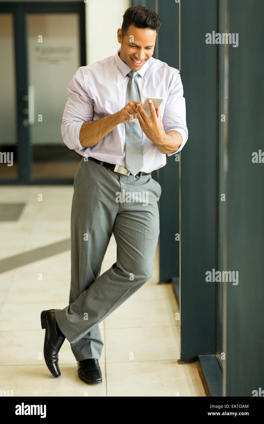 professional businessman using cell phone - Stock Image