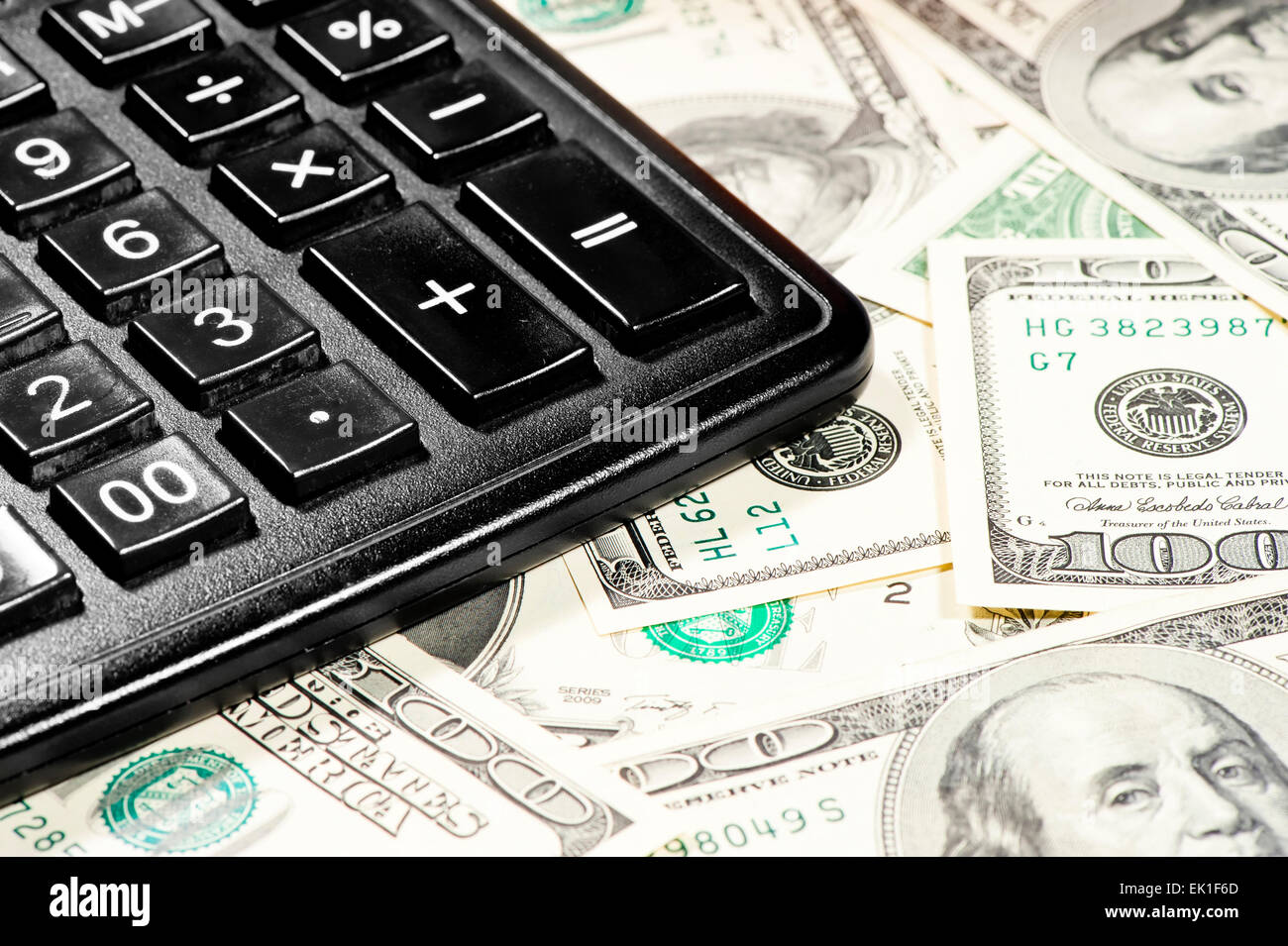 counting profits earned on the calculator - Stock Image