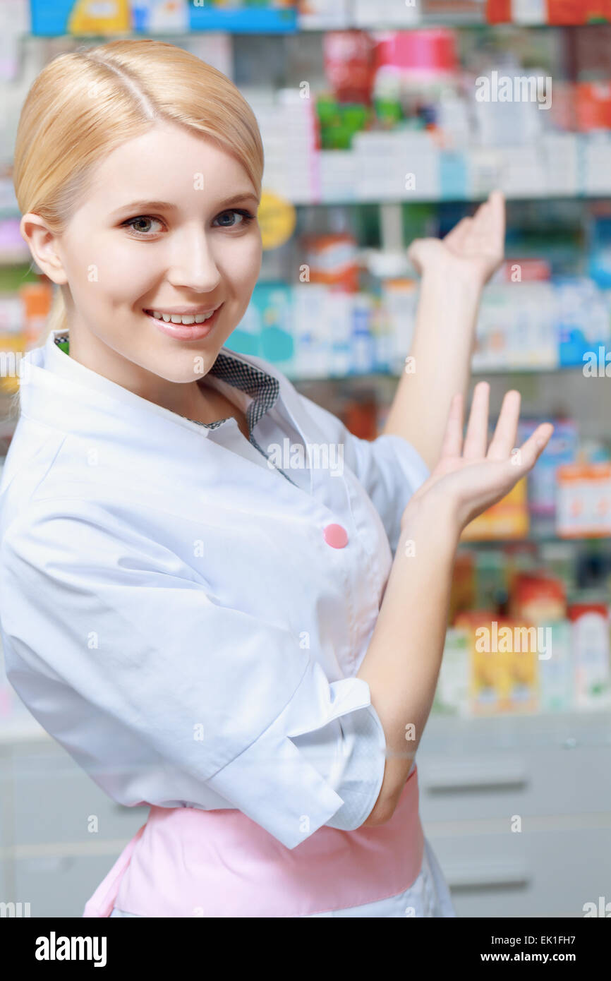 Pharmacist working at the drugstore - Stock Image
