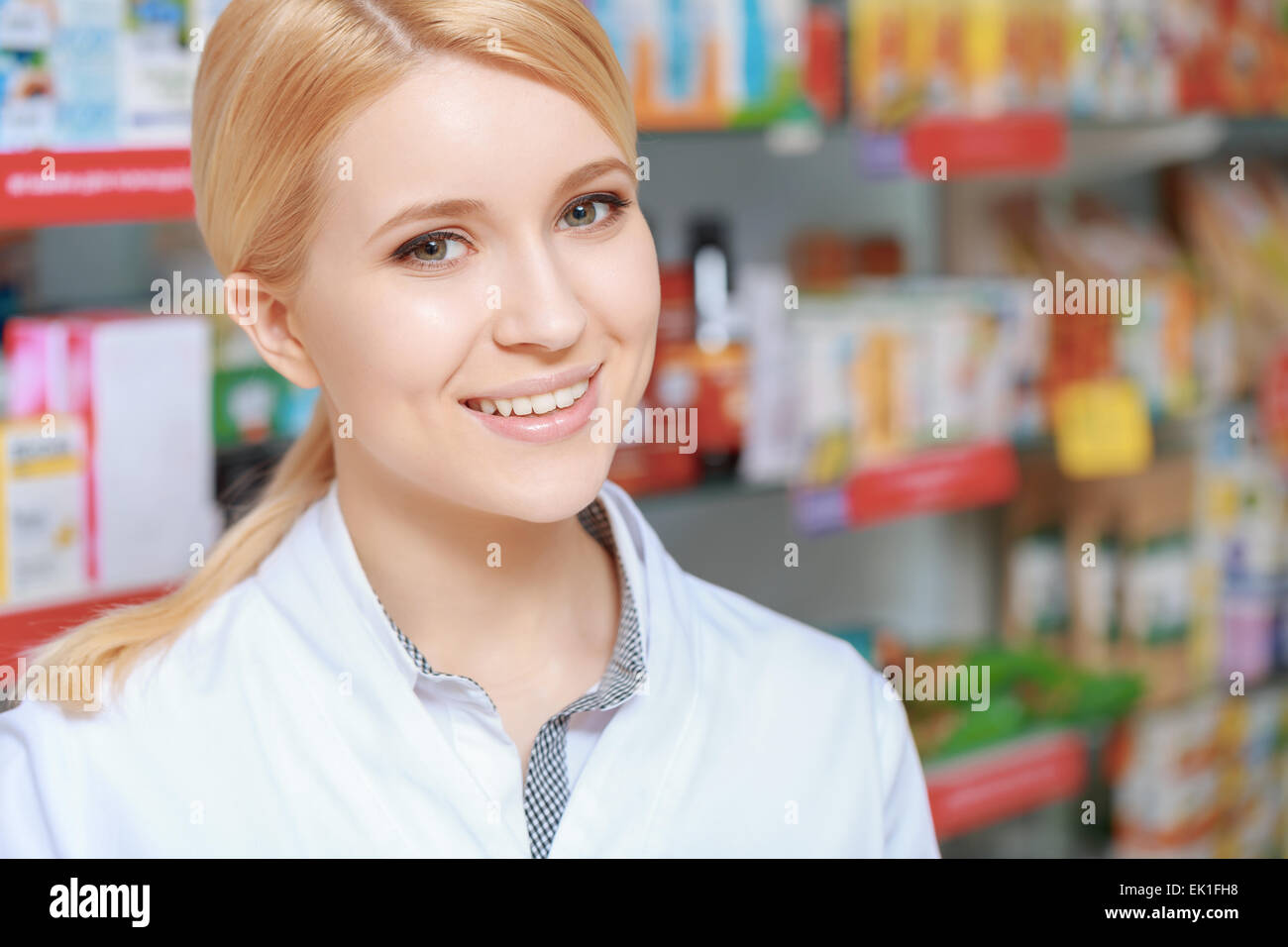 Helpful and smiling pharmacist - Stock Image