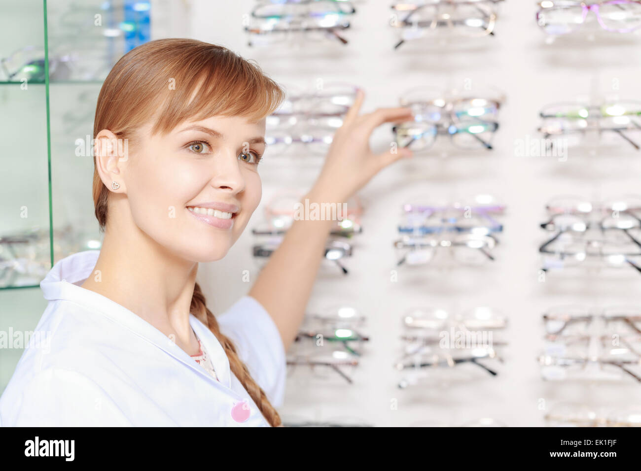 Health care consultant near the spectacles stand - Stock Image