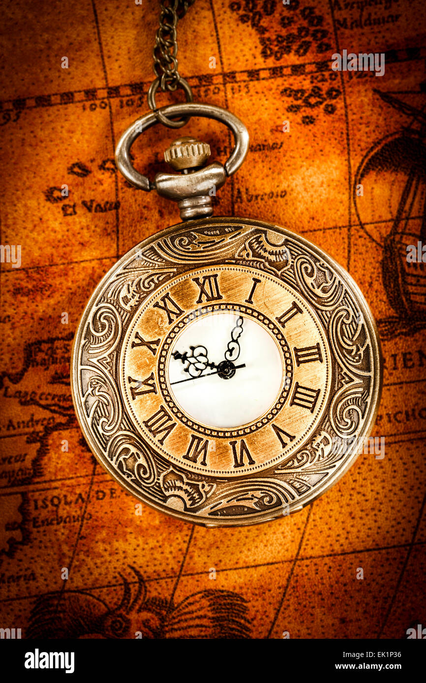 Vintage antique pocket watch on an ancient world map in 1565 stock vintage antique pocket watch on an ancient world map in 1565 gumiabroncs Gallery