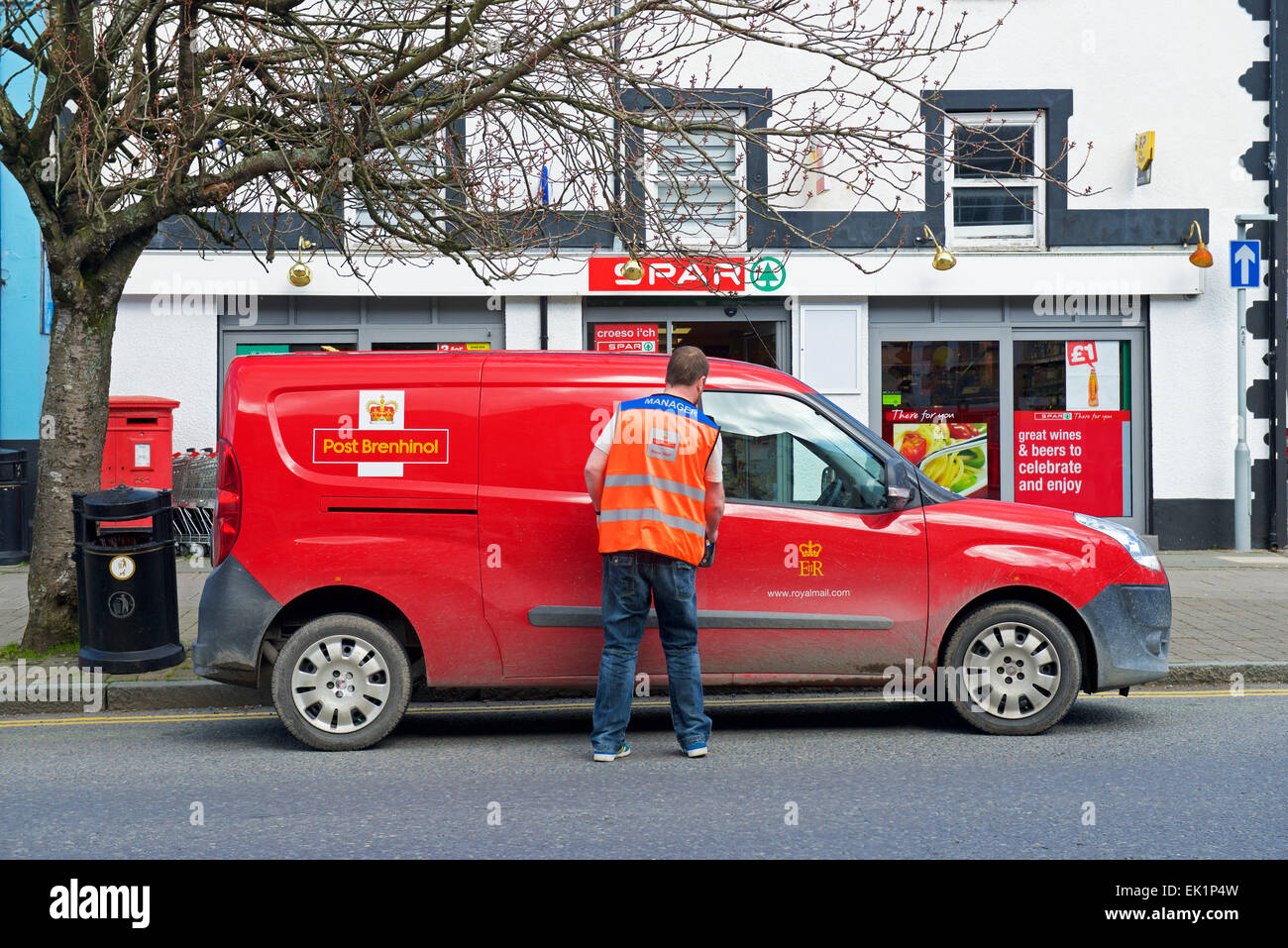 Postman and Royal Mail van - Stock Image