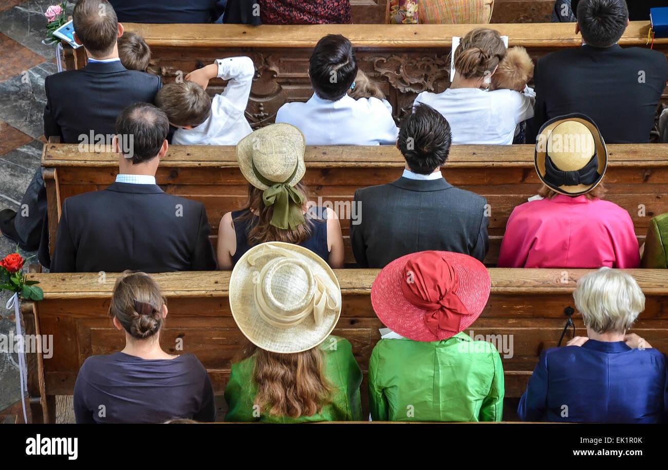 classic wedding,  church wedding, wedding guests  wedding hats - Stock Image