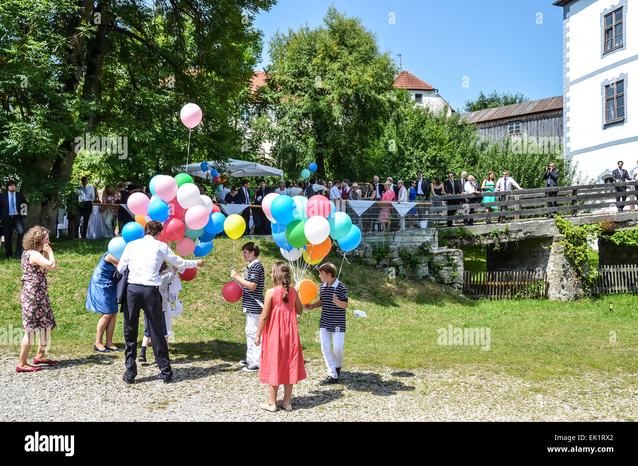 wedding ceremony multicoloured balloons with notices best wishes  soaring into the blue sky - Stock Image