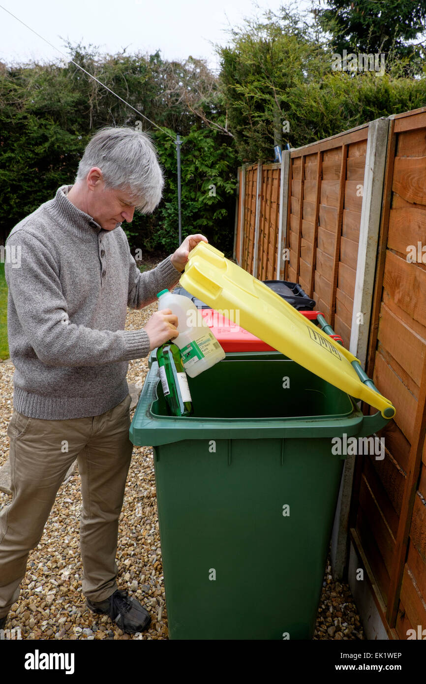 Many councils provide wheelie-bins for the recycling of household waste such as paper, plastic, tin and glass. Stock Photo
