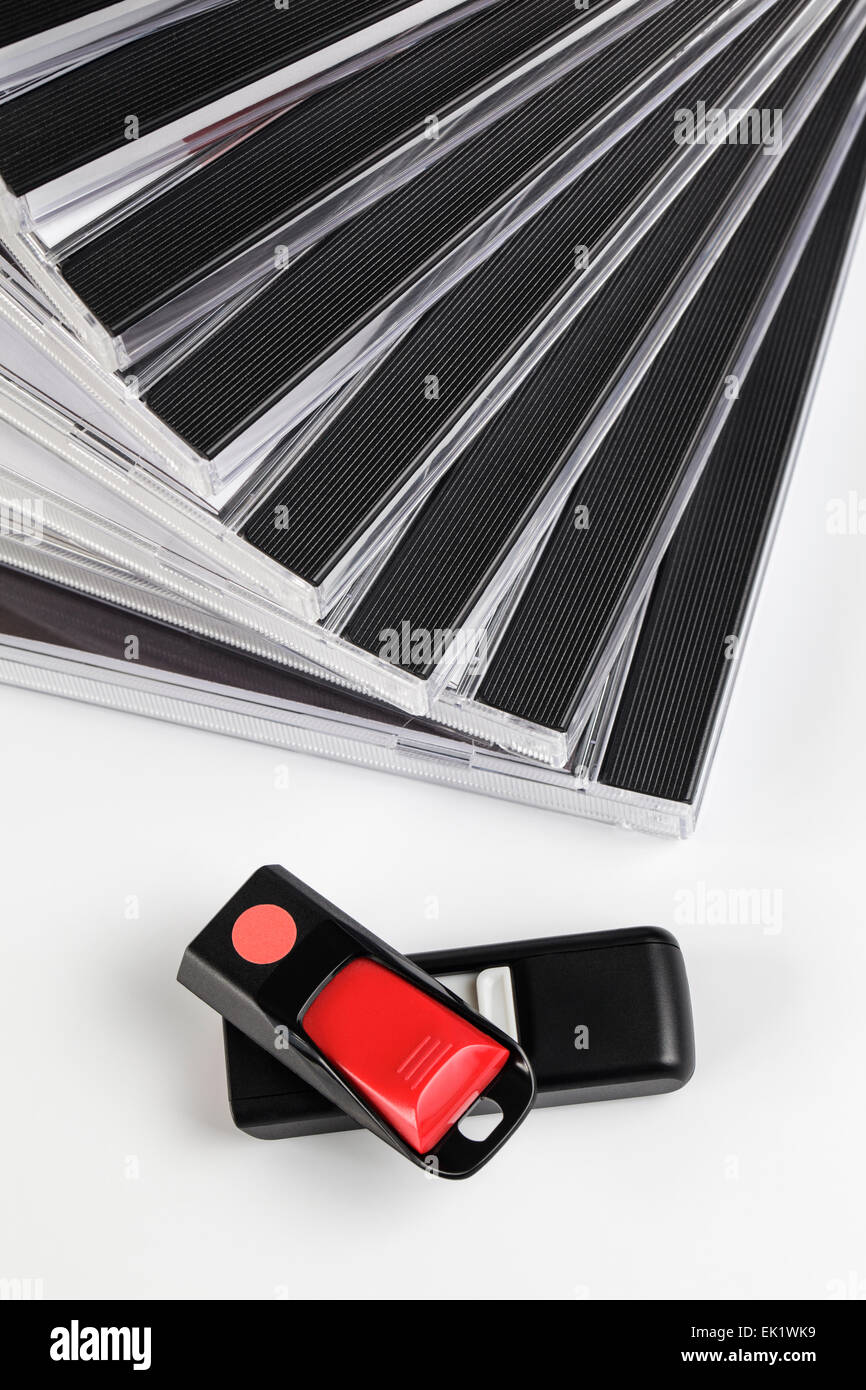 Two USB Flashdrives and a stack of DVD's - Stock Image