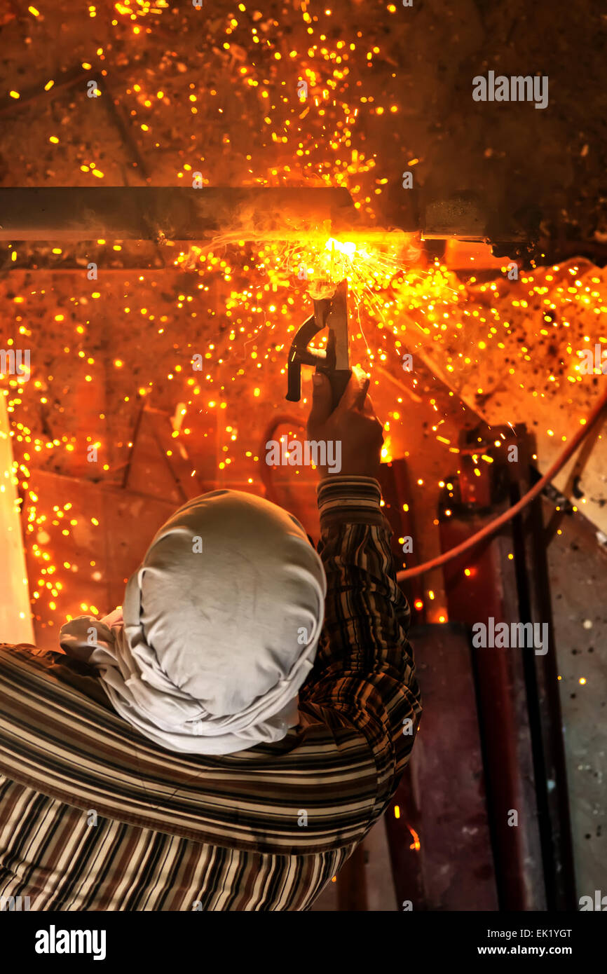 welding steel with spread spark lighting smoke - Stock Image