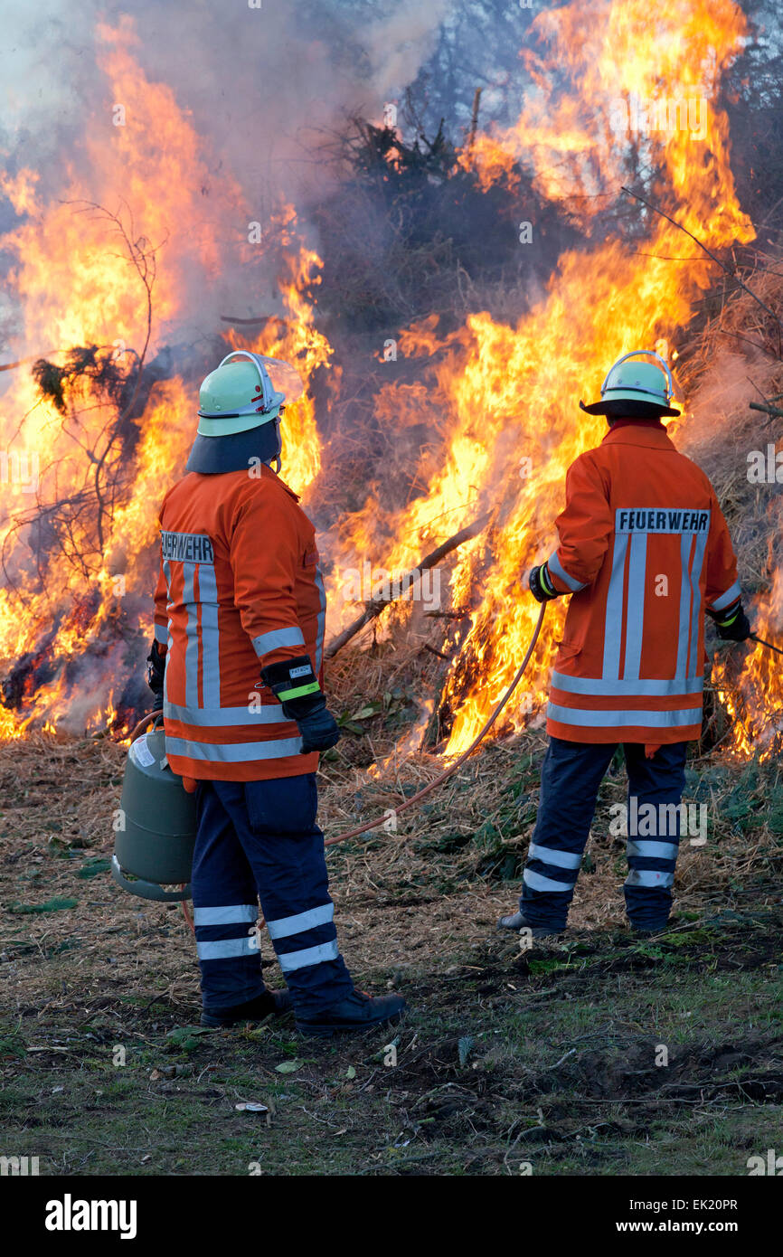 firemen lighting Easter eve bonfire, Neetze, Lower Saxony, Germany - Stock Image