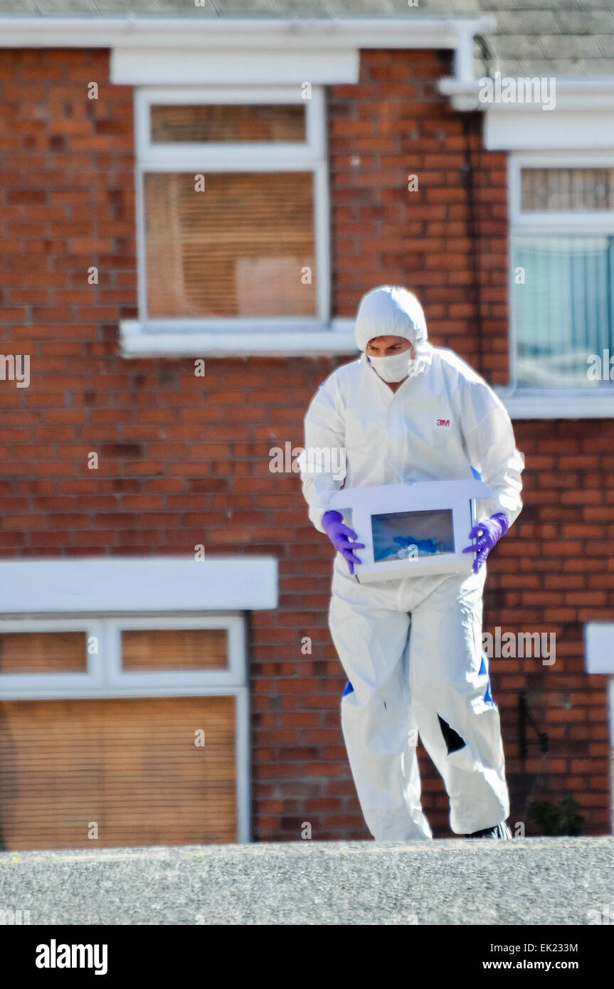 25th August 2013, Belfast - A Forensics officer gathers evidence into a box during a security alert in East Belfast - Stock Image