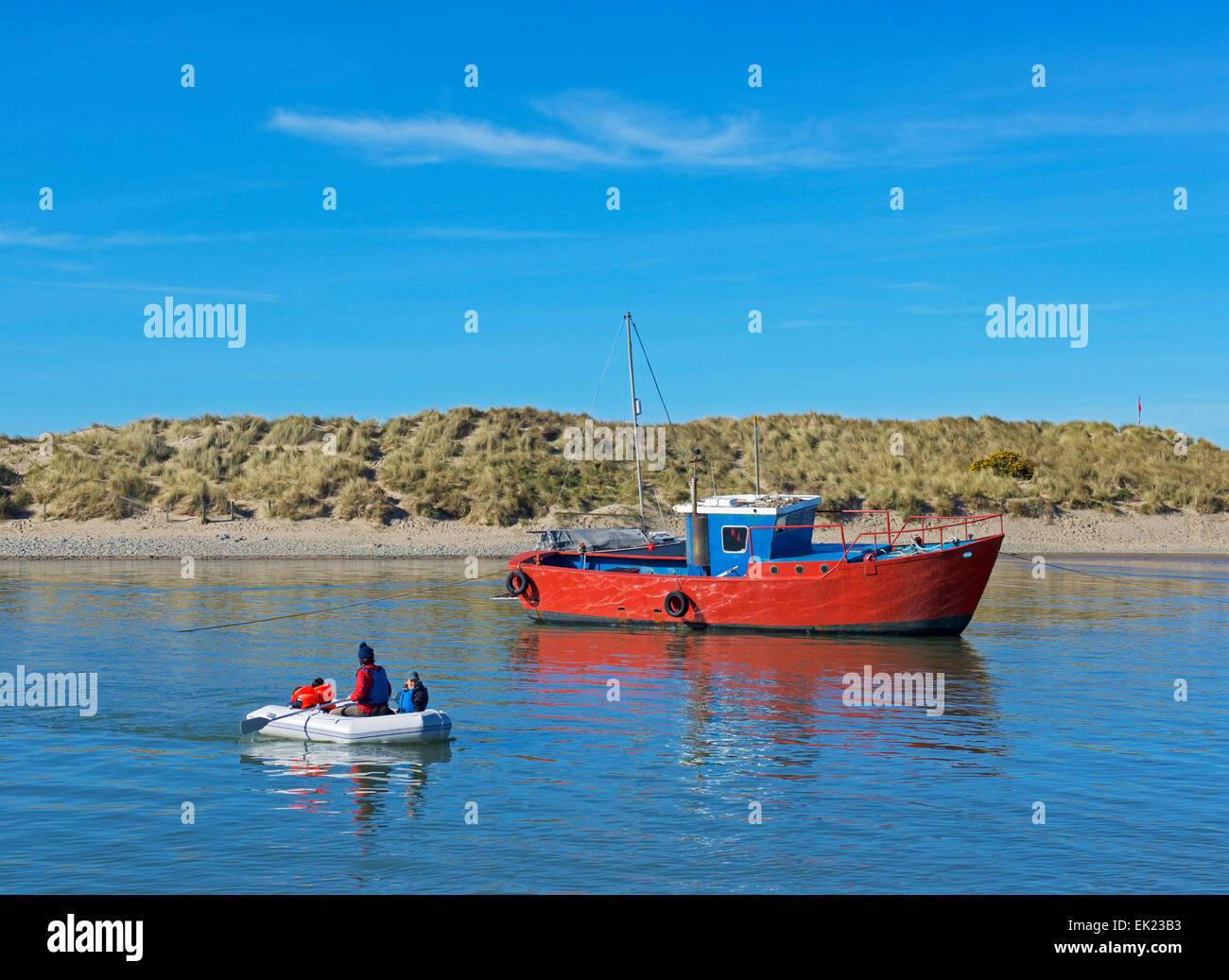 Family in inflatable dinghy at Barmouth, Gwynedd, Wales UK - Stock Image