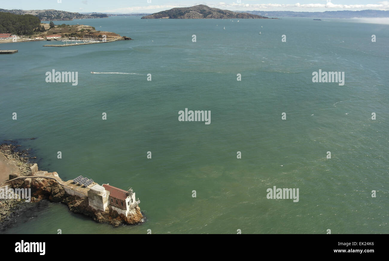Sunny view Golden Gate Bridge above Lime Point Fog Station, to Batteries Yates and Cavallo, Angel Island, San Francisco - Stock Image