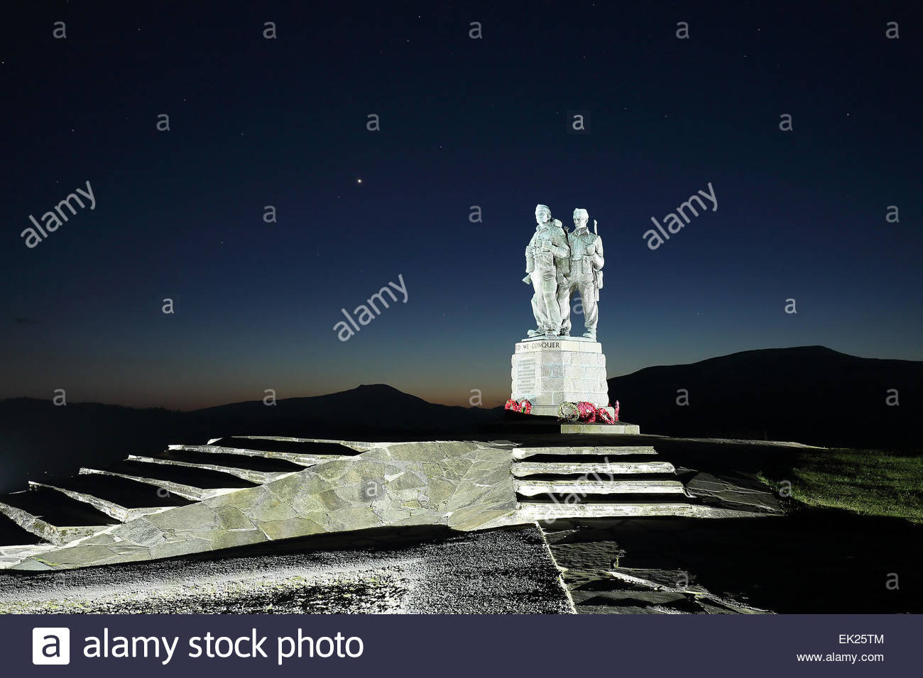 Evening twilight shot of the Commando memorial on a clear evening with a star filled sky - Stock Image