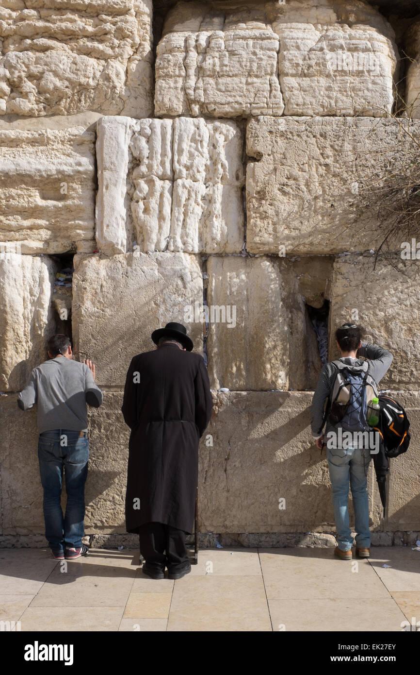 Jewish men praying at the Western Wall Jerusalem - Stock Image