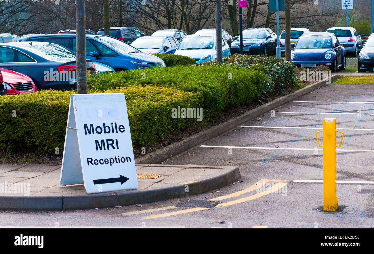 Mobile MRI scanning sign in a car park - Stock Image