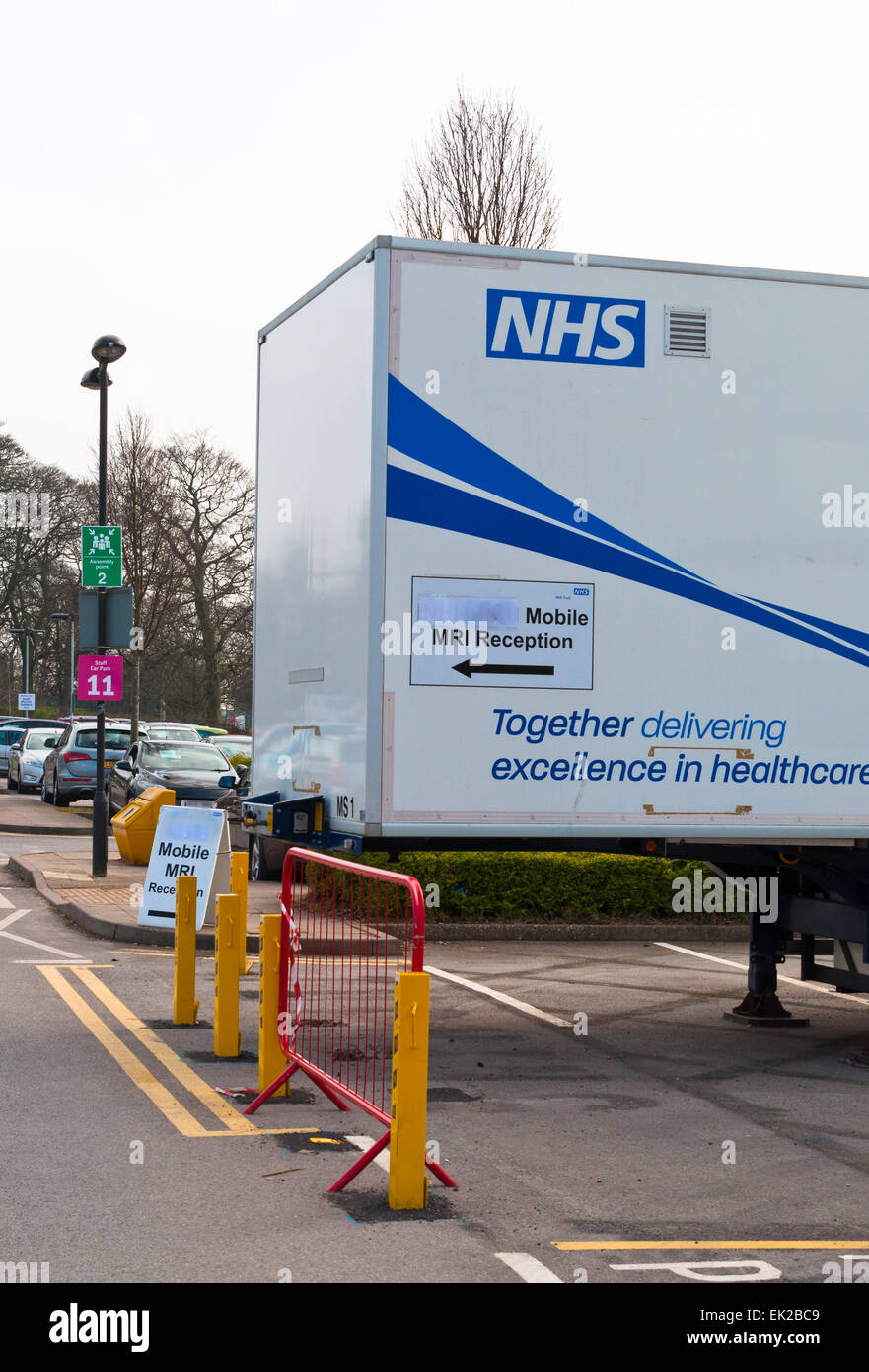 Mobile MRI scanning unit in a hospital car park vertical view - Stock Image