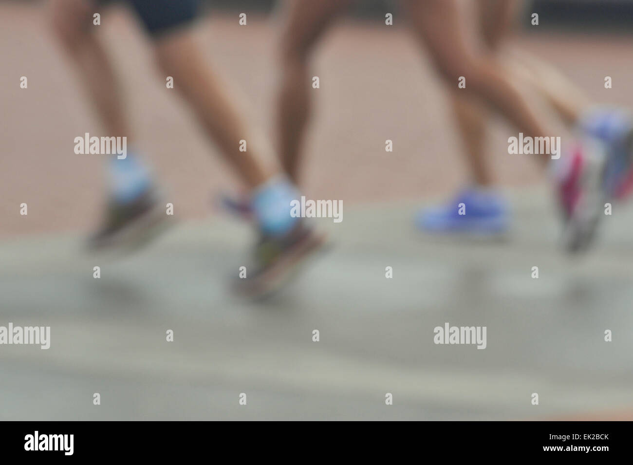 Blur, legs of three women runners running in group, people, fitness, activity, lifestyle - Stock Image