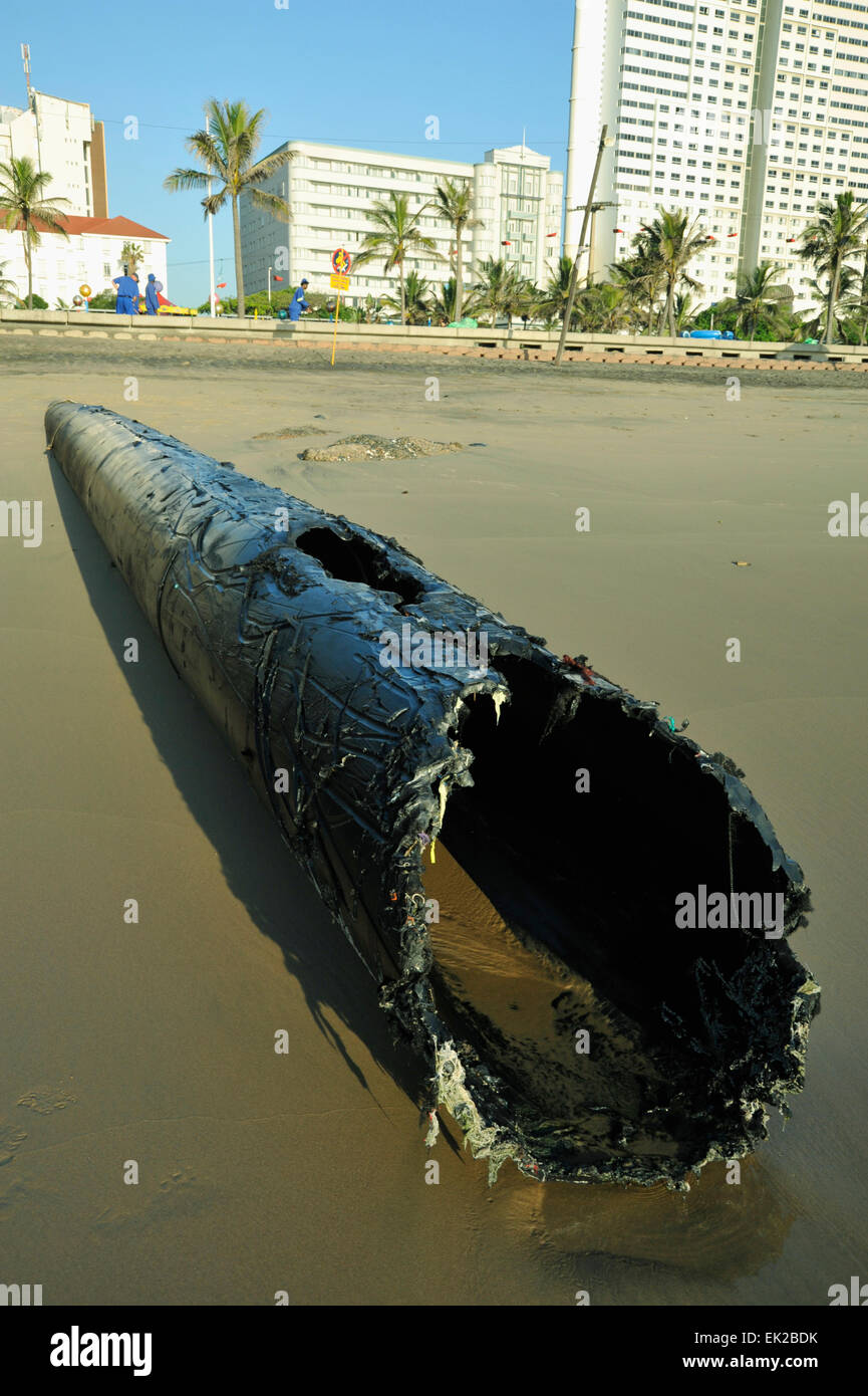 Exposed storm water sewage discharge pipe on public beach Durban South Africa - Stock Image