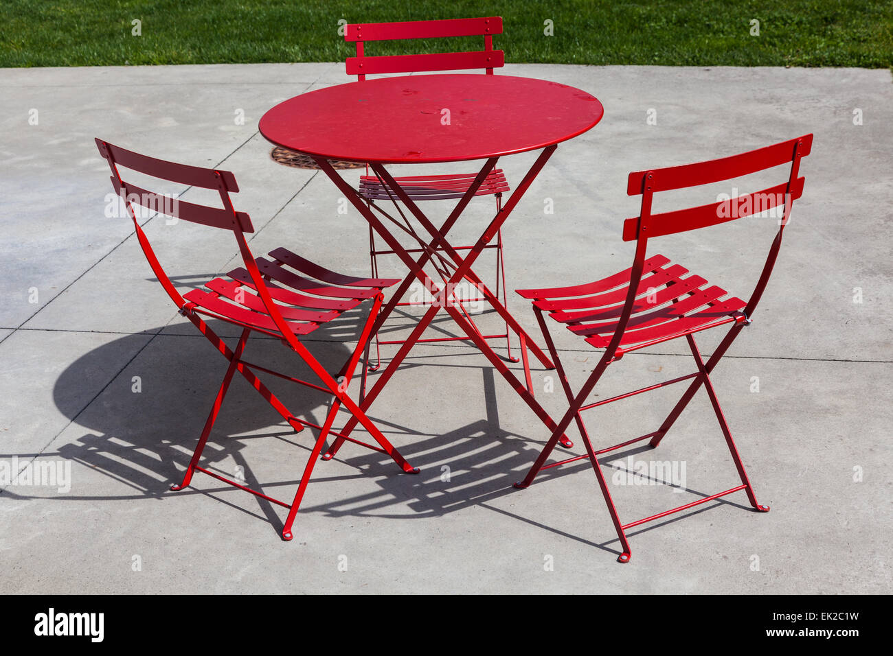 Miraculous Red Folding Patio Chairs And Table On A Concrete Surface Gmtry Best Dining Table And Chair Ideas Images Gmtryco