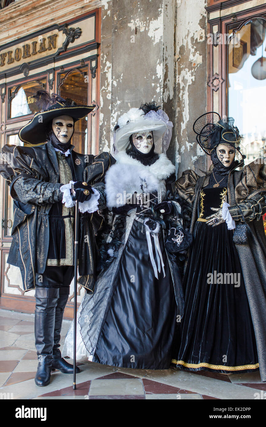 Three People in Carnival Mask and Costume, Venice, Italy Stock Photo