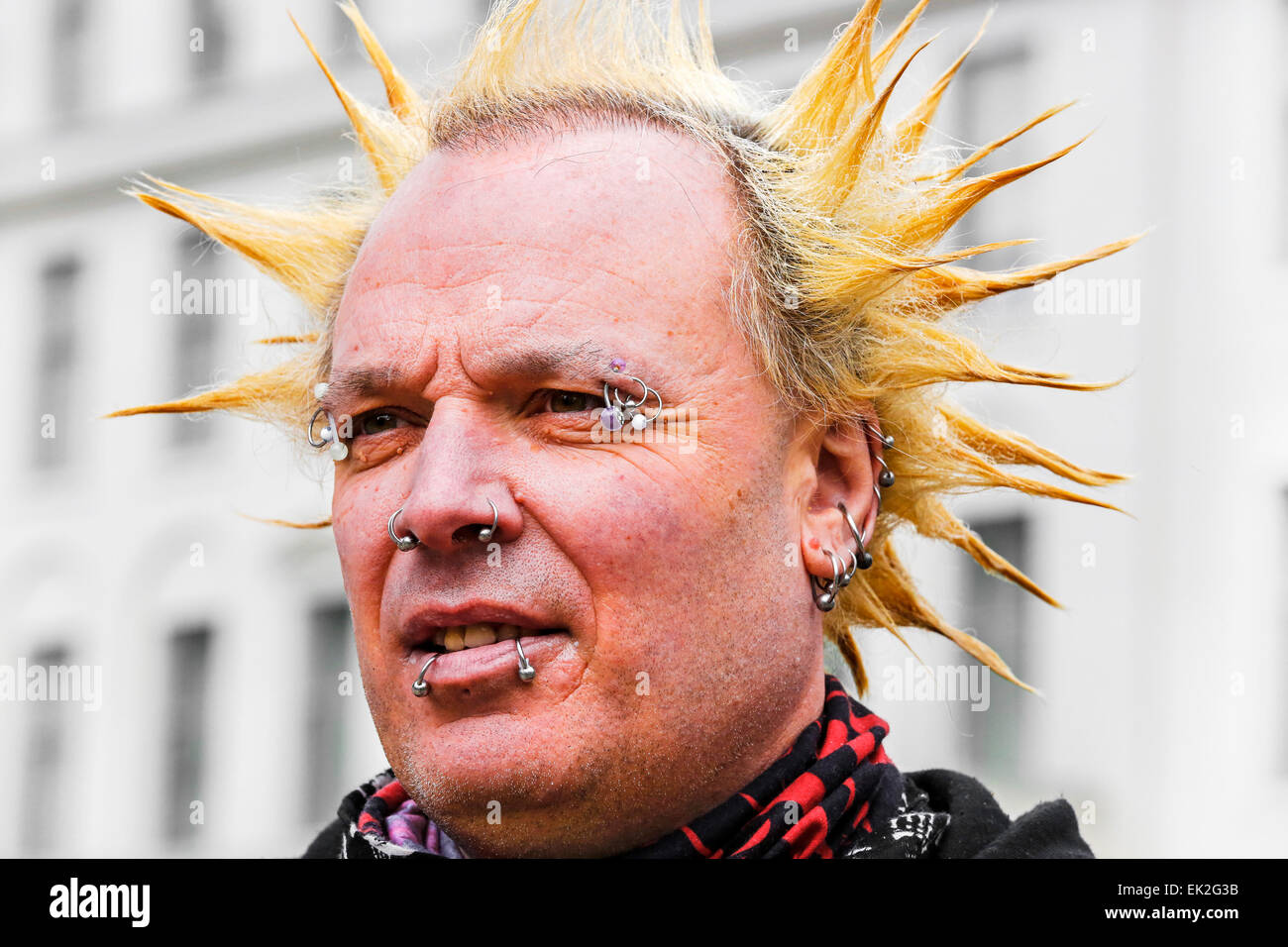 Man with punk haircut and face studs, Glasgow, Scotland, UK - Stock Image