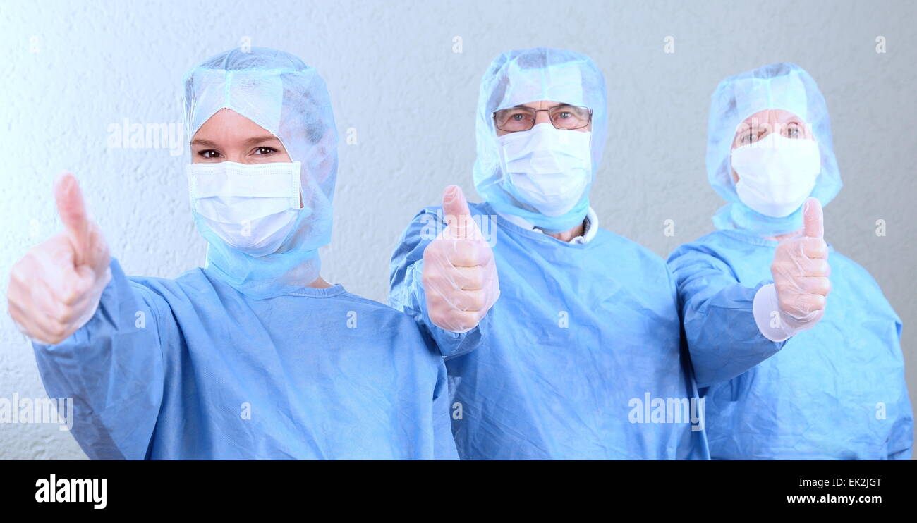Three doctors with thump up - Stock Image