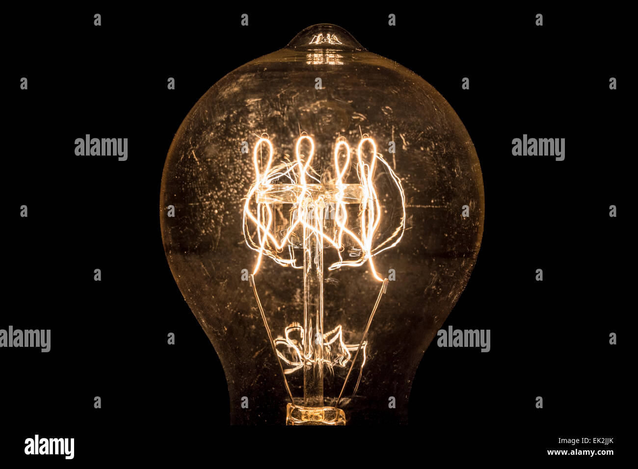 Vintage Incandescent Light Bulb Filament On Black.   Stock Image