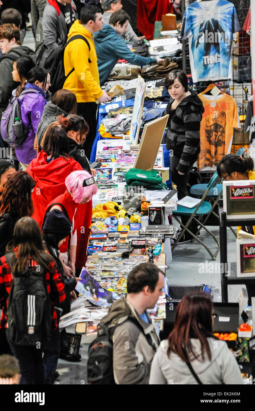 Customers swarm around a stall selling goods at a sci-fi conventiong - Stock Image