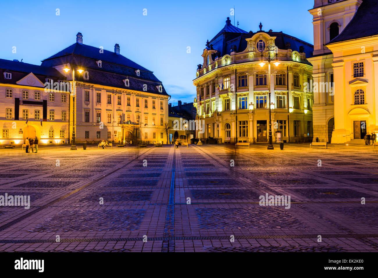City hall and Brukenthal palace in Sibiu, Transylvania, Romania, at night Stock Photo