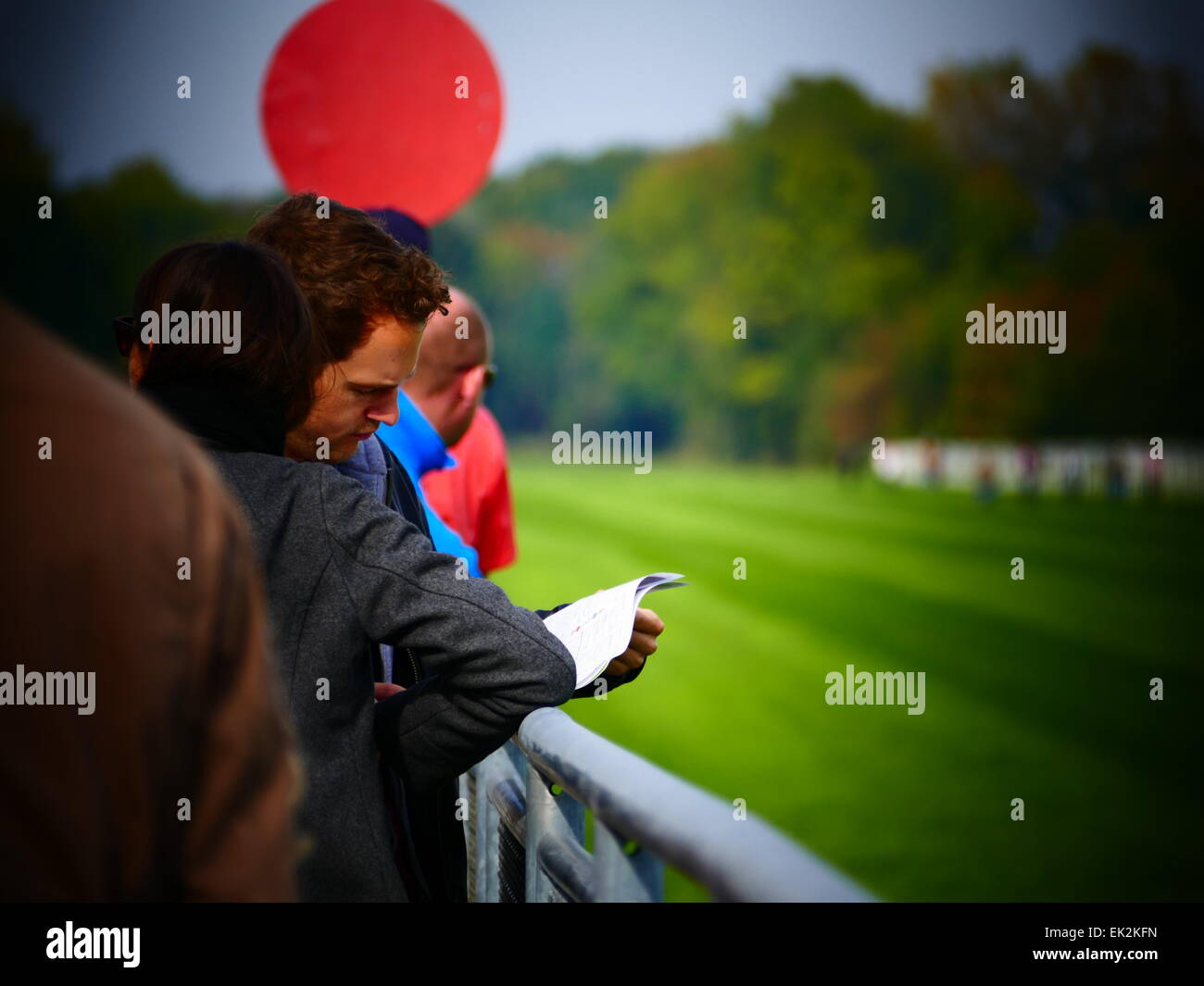 People at Track studing racing program Horse Race Racing - Stock Image
