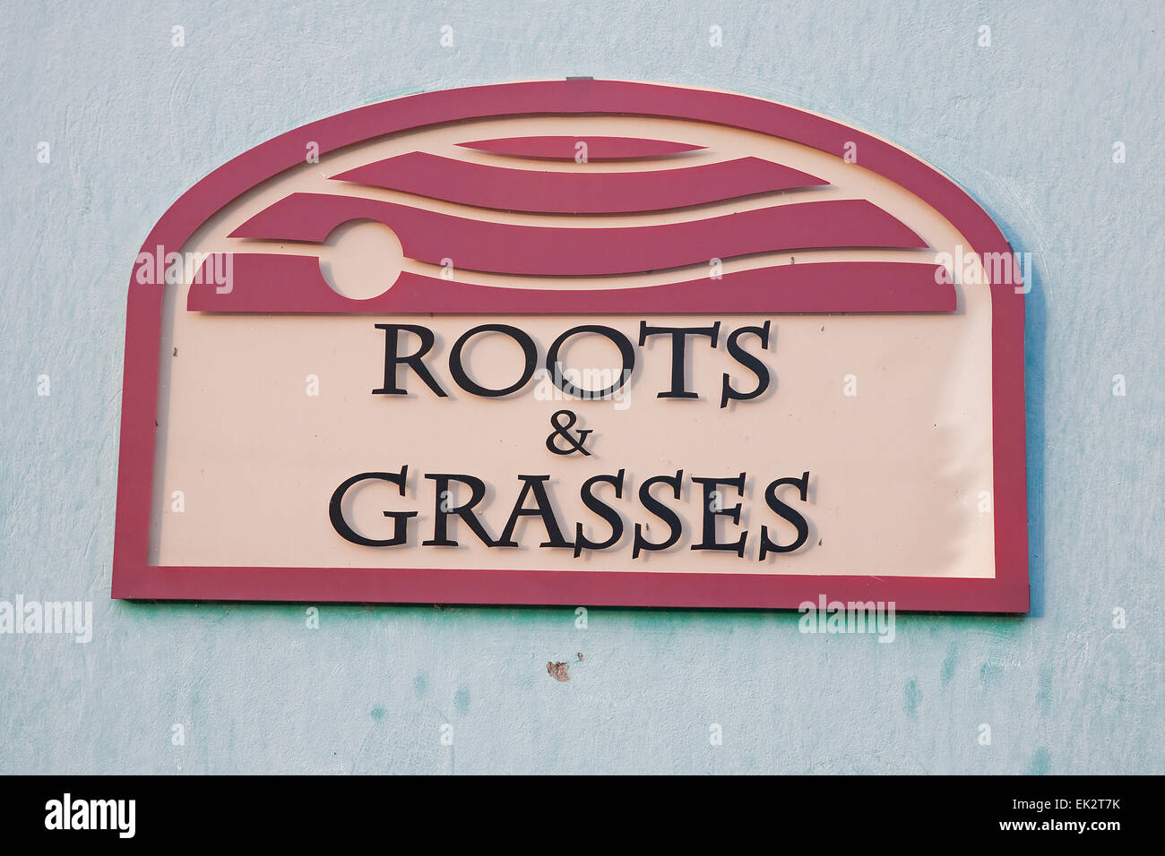 Roots and grasses sign in Barbados - Stock Image