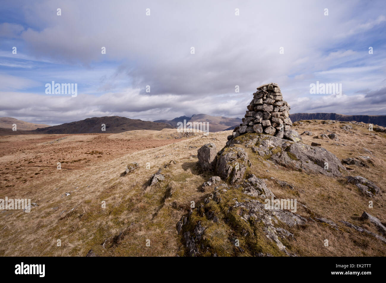 The summit cairn on top of Buckbarrow fell in the English Lake District on beautiful day during the bank holiday - Stock Image