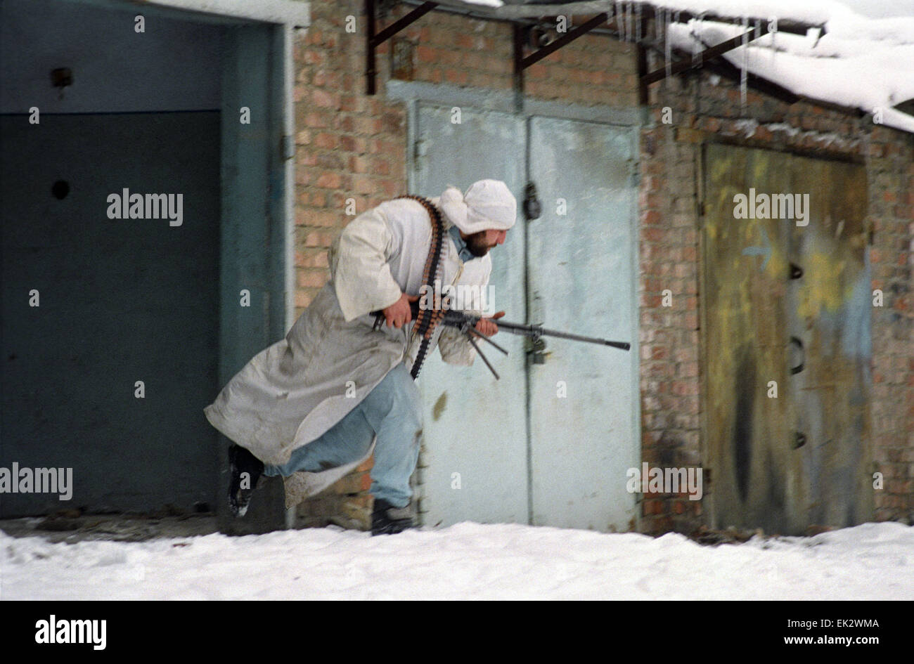 Grozny. A Chechen citizen soldier changes the position during a street combat. - Stock Image