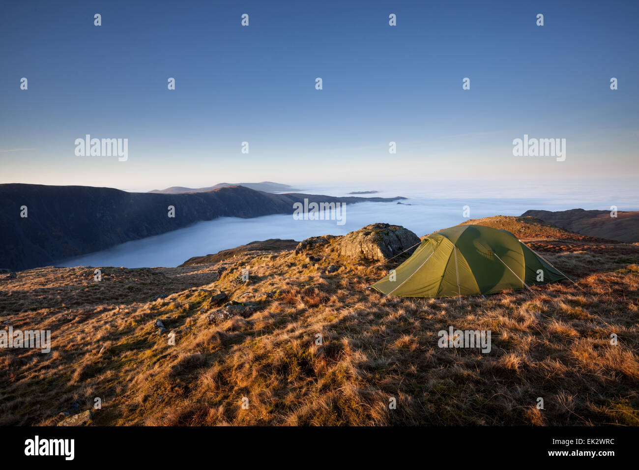 Sunrise and cloud inversion over Wastwater from our wild camping tent pitch on top of Middle Fell in the Lake District - Stock Image