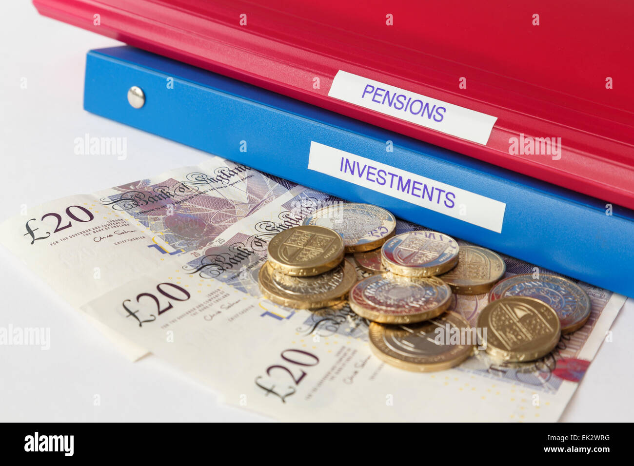 Pensions and Investments portfolios with sterling £20 twenty pound notes and coins. Investing money in stocks - Stock Image