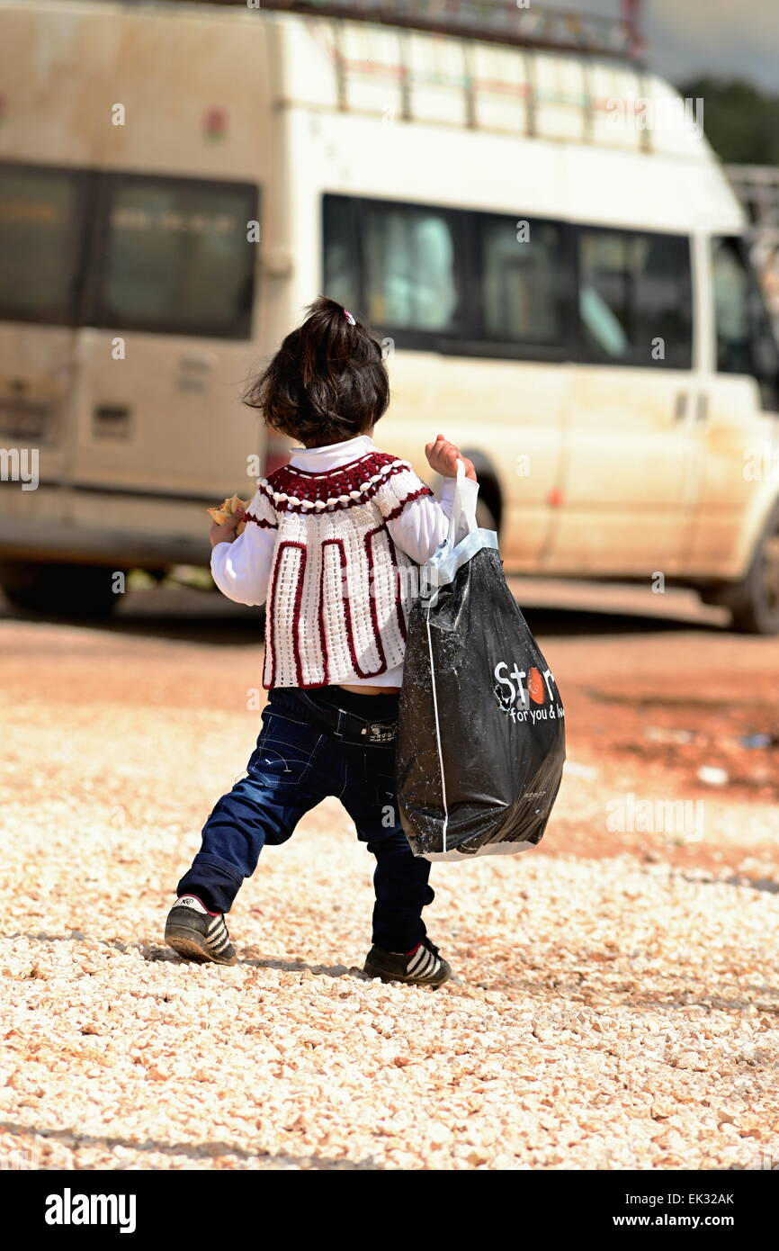 many children returning into Konbane with their parents. 3.4.2015, Kobane, Syria Stock Photo