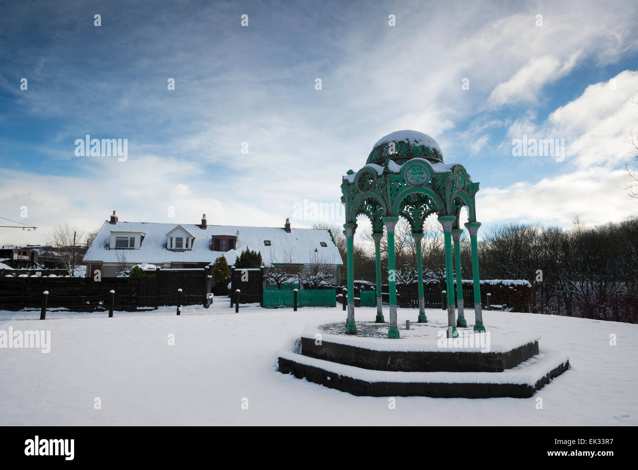 Bandstand on snow covered green in Summerlee Industrial Heritage Museum. - Stock Image